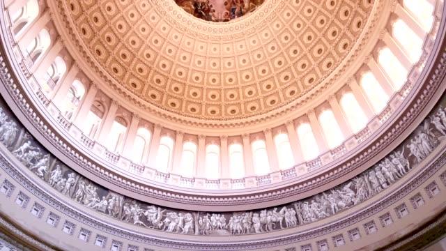 u.s. capitol building rotunda tilt up to interior dome in washington, dc - tilt up - rotunda stock videos & royalty-free footage