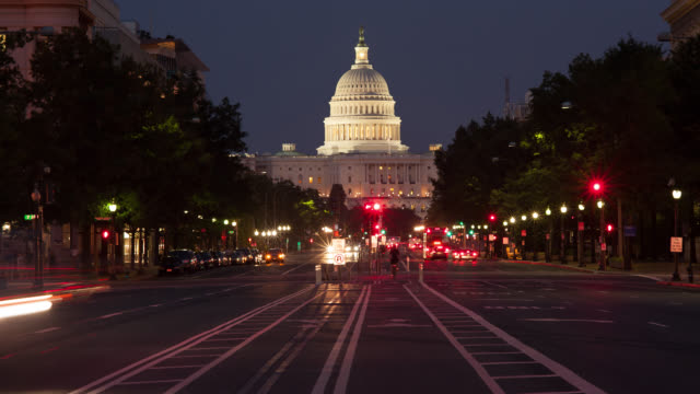 WS T/L US Capitol Building with Pennsylvania Avenue at dusk / Washington DC, United States