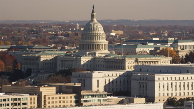 us capitol building with rayburn house office building in foreground. shot in 2011. - united states congress stock-videos und b-roll-filmmaterial