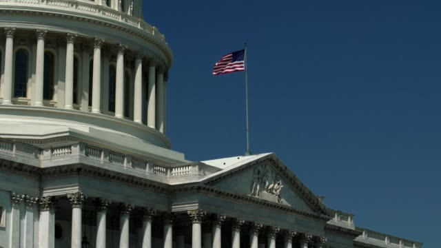 U.S. Capitol East Facade and American Flag Waving Zoom In
