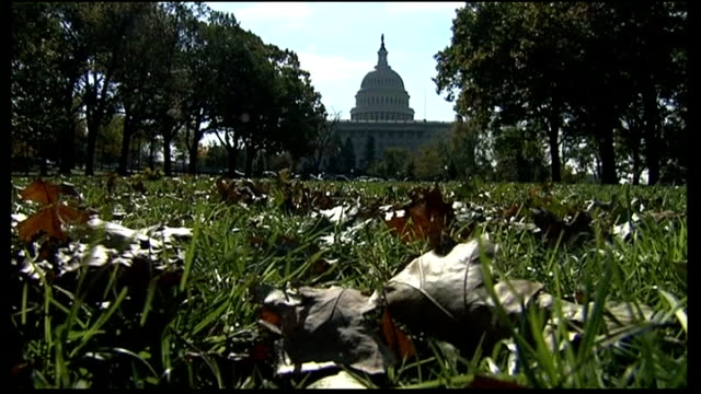 Capitol Hill deadlocked over budget cuts USA Washington DC EXT Wide shot of United States Capitol building with autumn leaves lying on grass in...