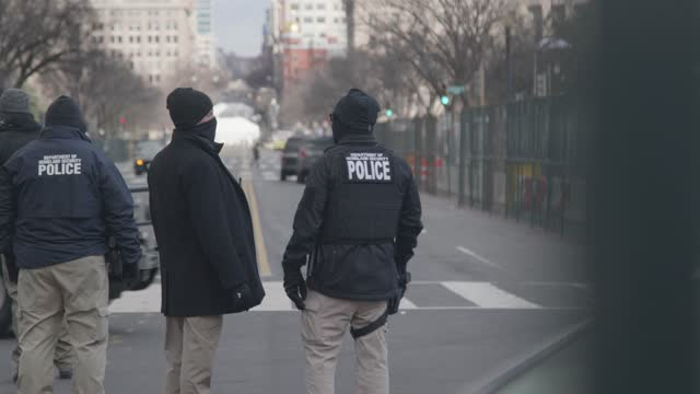 capitol police stand guard on independence avenue at the u.s. capitol on inauguration day on january 21, 2021 in washington, dc. joe biden was sworn... - four people stock videos & royalty-free footage