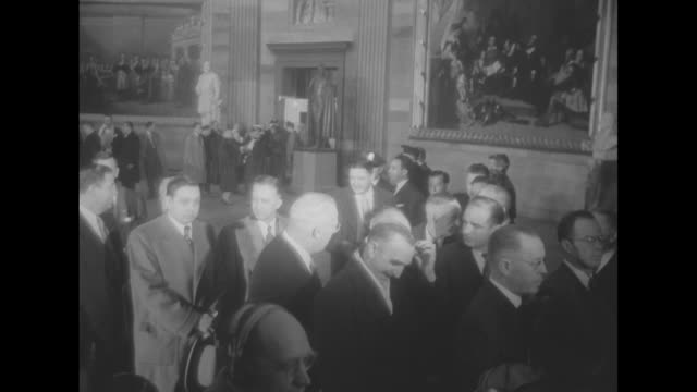 capitol rotunda elevated view of long line of dignitaries filing in / vs dignitaries pass through doorway including bess truman, mamie eisenhower,... - u.s. supreme court stock videos & royalty-free footage