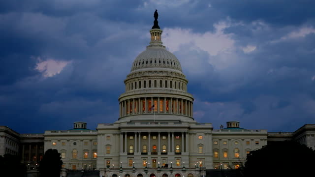 us capitol west facade at dusk with clouds - tl - capitol building stock videos & royalty-free footage