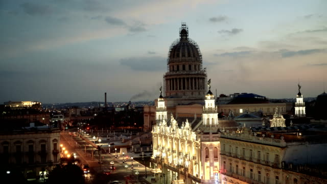 capitolio at dusk in havana, cuba - vintage car stock videos and b-roll footage