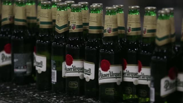 capped green bottles of beer move along conveyor belts on the automated production line at the pilsner urquell brewery operated by sabmiller plc in... - pilsner stock videos & royalty-free footage