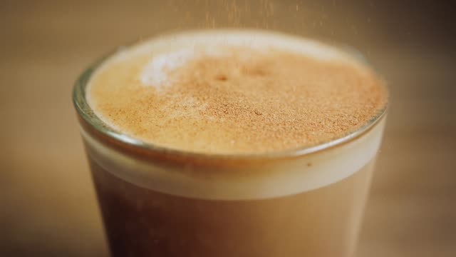 cappuccino 1 with sprinkles - sprinkles stock videos and b-roll footage