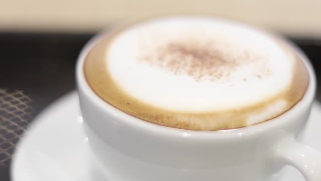 cappuccino coffee cup on wood table - cafeteria worker stock videos and b-roll footage