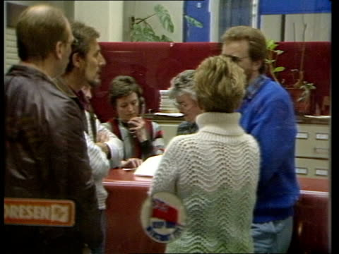 dover:; a) england: dover: night townsend thoresen hq int reception area with people waiting official leads woman to door l-r and others follow and... - passenger craft stock videos & royalty-free footage