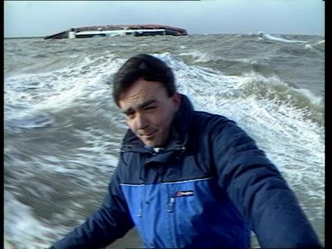 stockvideo's en b-roll-footage met salvage minimal entry belgium zeebrugge heavy seas around herald of free enterprise mates i/c in choppy seas steel salvage piles sticking out of... - zeebrugge