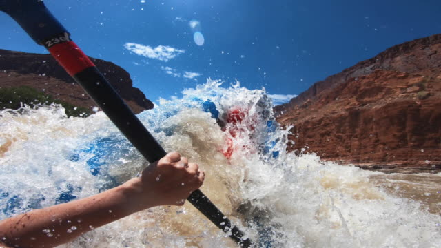pov capsizing while rafting with kayak in colorado river - rapid stock videos & royalty-free footage