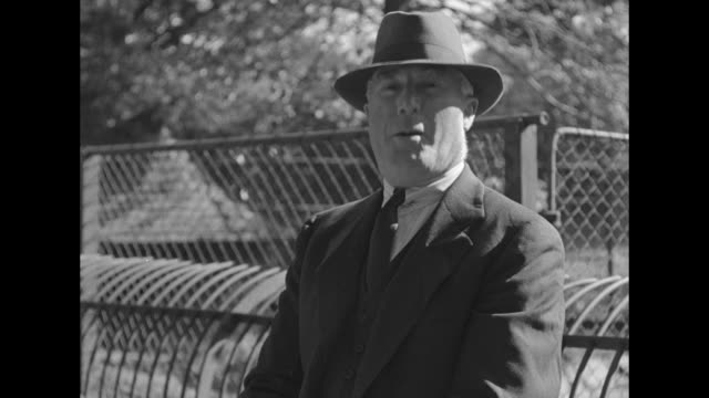 capt bob bartlett seated outdoors at the bronx zoo and dressed in a suit and fedora records an introduction for a segment about the baby walrus peel... - effie stock videos and b-roll footage