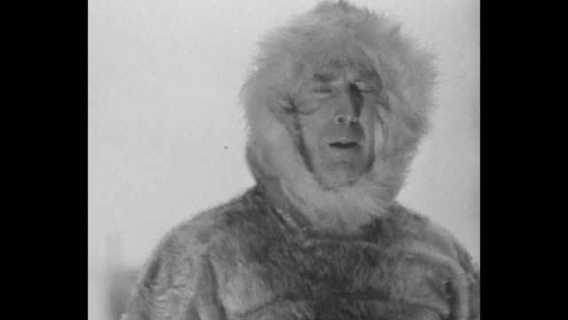 CU Captain Bob Bartlett wearing fur anorak speaking of being with Admiral Robert Peary near the North Pole