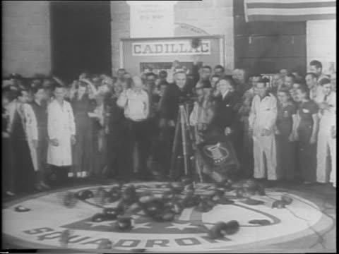 captain eddie rickenbacker escorted by henry ford to plane surrounded by reporters / long shot of crowd gathered around plane / rickenbacker... - autographing stock videos and b-roll footage