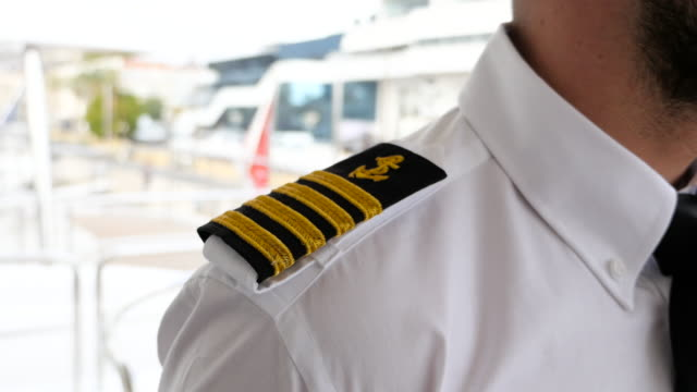 captain epaulet. - marinaio video stock e b–roll