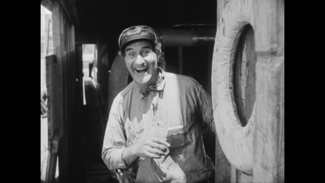 1928 a captain (ernest torrence) is amused when he sees a rival (tom mcguire ) has fallen into the river - 1928 stock videos & royalty-free footage