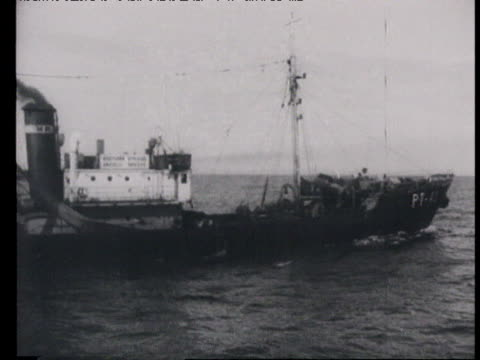 captain looking through sextant fishermen throwing nets fishing trawler at sea fishermen pulling out net loaded with fish / russia - 1940 stock videos & royalty-free footage