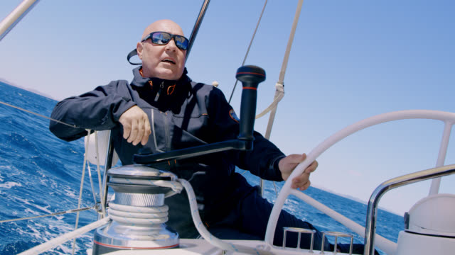 WS Captain navigating a sailboat on the sea