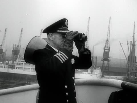 a captain of an ocean liner looks through his binoculars - binoculars stock videos & royalty-free footage