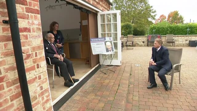 captain sir tom moore presented with first veterans' railcard; england: bedfordshire: marston moretaine: ext grant shapps mp stands chatting with... - daughter stock videos & royalty-free footage