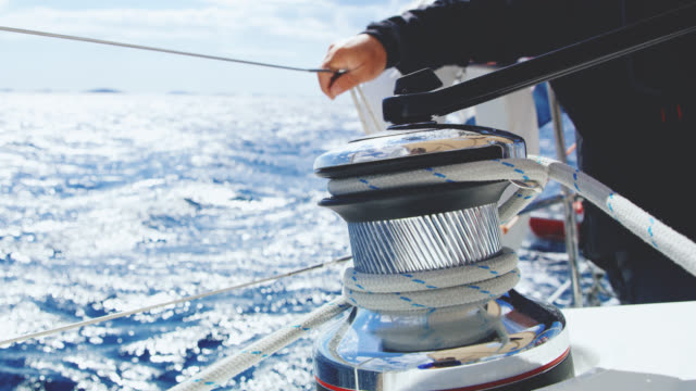 ms captain sitting behind a winch on a boat - equipaggio video stock e b–roll