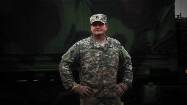 captain standing in front of convoy truck - army soldier stock videos & royalty-free footage