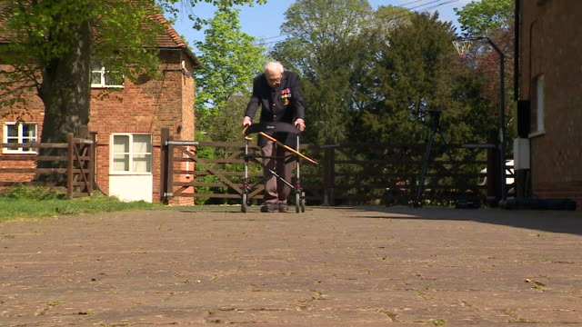 captain tom moore 99 years old attempting to walk 100 laps of his bedfordshire garden during lockdown to raise money for the nhs during the... - captain tom moore stock videos & royalty-free footage