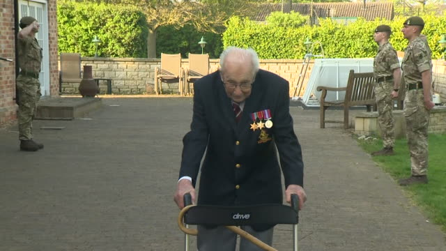 captain tom moore 99 years old finishing his final 100 laps of his garden as his fundraising effort for the nhs during coronavirus lockdown raises so... - captain tom moore stock videos & royalty-free footage