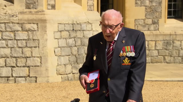 "captain tom moore saying it was ""outstanding"" to receive his knighthood from queen elizabeth ii - organisation stock videos & royalty-free footage"