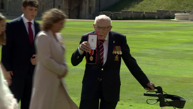 captain tom moore with his family and queen elizabeth ii after being knighted at windsor castle - grandfather stock videos & royalty-free footage