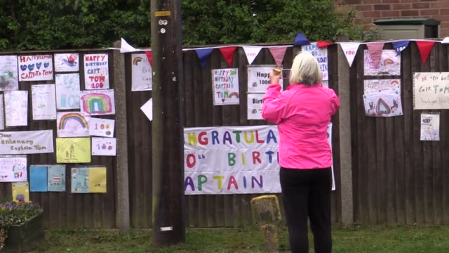 captain tom moore's village of marston moretaine in bedfordshire celebrates the veteran's 100th birthday with signs cards and banners the veteran's... - captain tom moore stock videos & royalty-free footage