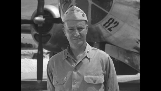 captain william sterling parsons of the us navy stands on airfield in front of the enola gay he served as weaponeer and mission commander during the... - bomber stock-videos und b-roll-filmmaterial