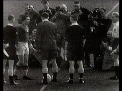 captains billy wright and ferenc puskas shake hands before coin toss and exchange of pennants, england vs hungary, international friendly, wembley... - コイントス点の映像素材/bロール