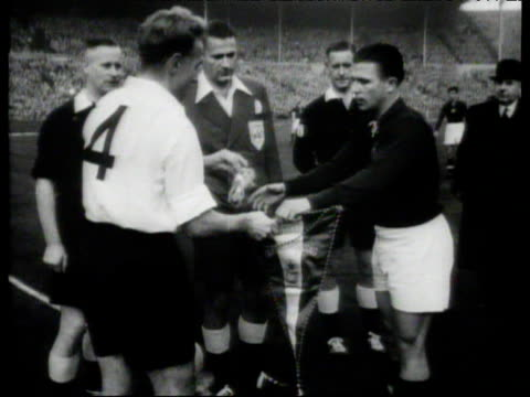 Captains Billy Wright and Ferenc Puskas shake hands before coin toss and exchange of pennants England vs Hungary International Friendly Wembley...