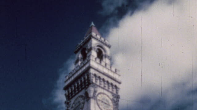 caption discussing organizing for victory, city hall clock and bell tower, directory of government offices on various floors, and mayor william... - air raid stock videos & royalty-free footage
