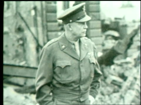 captions about their war plan appear above a photo of generals eisenhower, bradley, and patton amid rubble. - world title stock videos & royalty-free footage