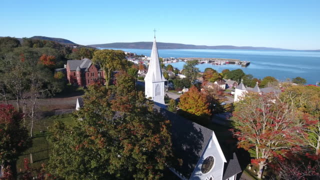 A captivating aerial view of Trinity Anglican Church and graveyard in Nova Scotia, Canada.