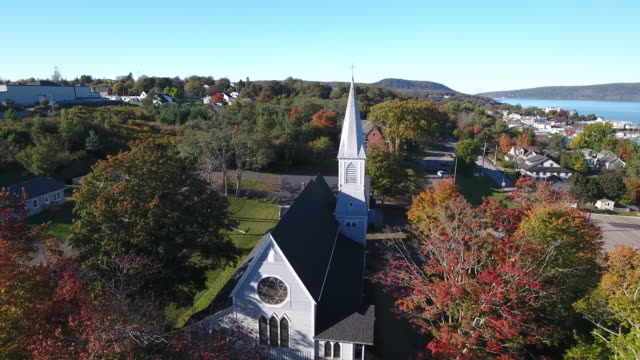a captivating aerial view of trinity anglican church and graveyard in nova scotia, canada. - nova scotia stock videos & royalty-free footage