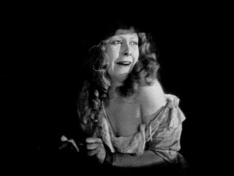 1926 b/w ms captive woman (charlotte stevens) crying and pleading / usa - 1926 bildbanksvideor och videomaterial från bakom kulisserna