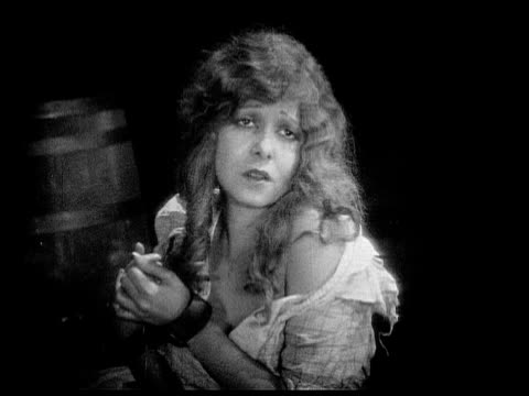 1926 b/w ms captive woman (charlotte stevens) falling asleep / usa - 縛られる点の映像素材/bロール