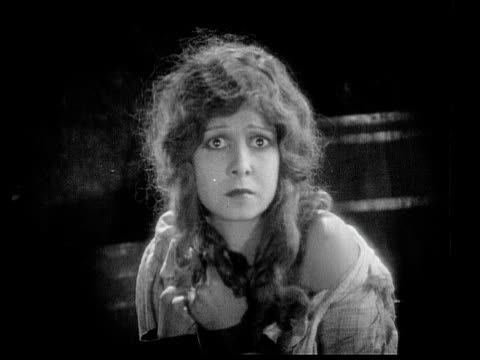 1926 b/w ms captive woman (charlotte stevens) looking fearful with wide eyes / usa - 1926 stock-videos und b-roll-filmmaterial