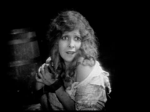 1926 b/w ms captive woman (charlotte stevens) whimpering and looking fearful / usa - 1926 stock videos & royalty-free footage