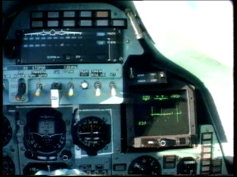 Capture of British spy announced TX 111193 AERIALs Sukhoi SU27 plane in flight LR Control panel in plane TILT UP front of cockpit as another plane...