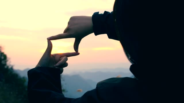 capture the sunset with hand - gesturing stock videos & royalty-free footage