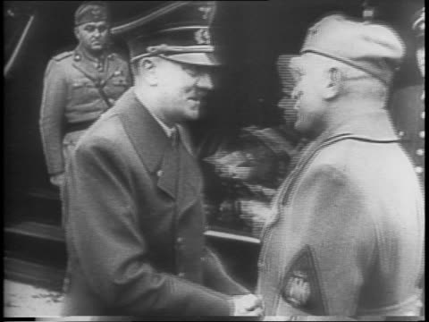captured film of adolf hitler meeting with benito mussolini in germany / mussolini and hitler walk together with others up steps / interior shot of... - benito mussolini stock videos & royalty-free footage