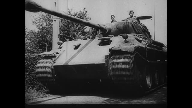 [captured german footage; vo music and french language throughout] pile of wreckage includes military vehicles and a tank / german officer shakes... - world war ii video stock e b–roll