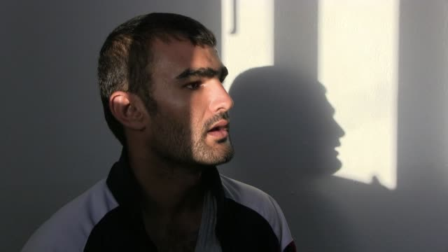 captured iraqi isis militant by the name of sina obeid at the interrogation room of the intelligence security unit of the asayiş or asayish the... - isis beheading stock-videos und b-roll-filmmaterial