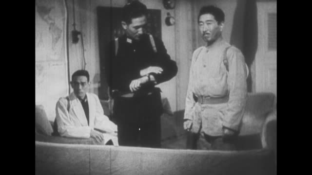 [captured japanese propaganda film] loudspeaker on battleship / three japanese officers in room, one looks at his watch, two wearing gas mask gear on... - lingua giapponese video stock e b–roll