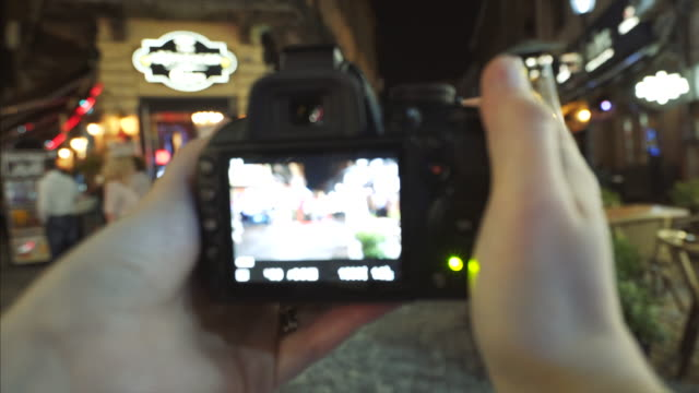 pov capturing beautiful city lifestyle. - photo shooting stock videos and b-roll footage