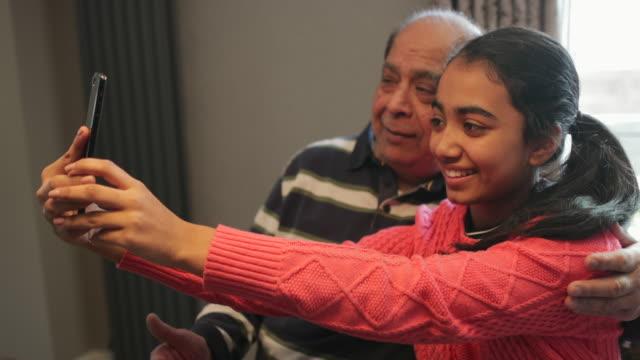 capturing memories with grandad - grandparent stock videos & royalty-free footage
